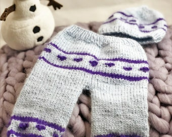 Knitted trousers with cap for a baby