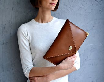 Seal brown leather clutch