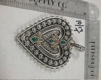 Beautiful  silvertoned heart pendant used