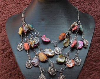 Mexican Milagro necklace with silver colored Milagros with mother of pearl beads