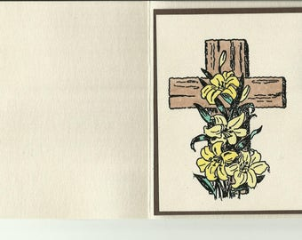 Yellow Lilies in front of Cross