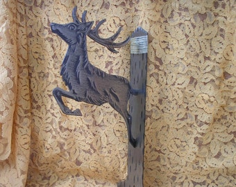 Brushed steel deer hanger