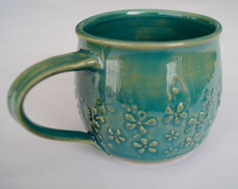 Hand-turned cup with floral ornament