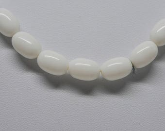 Lovely white tone beaded necklace