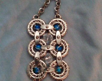 large silver wire wrapped pendant with blue beads