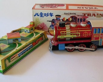 2 Vintage Wind Up and Friction Train Tin Toys
