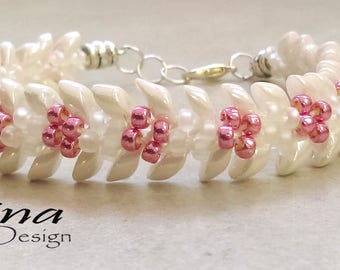Kumihimo beaded bracelet in White and Pink with Magatamas