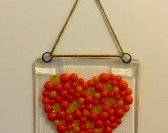 Fused glass heart hanging decoration.