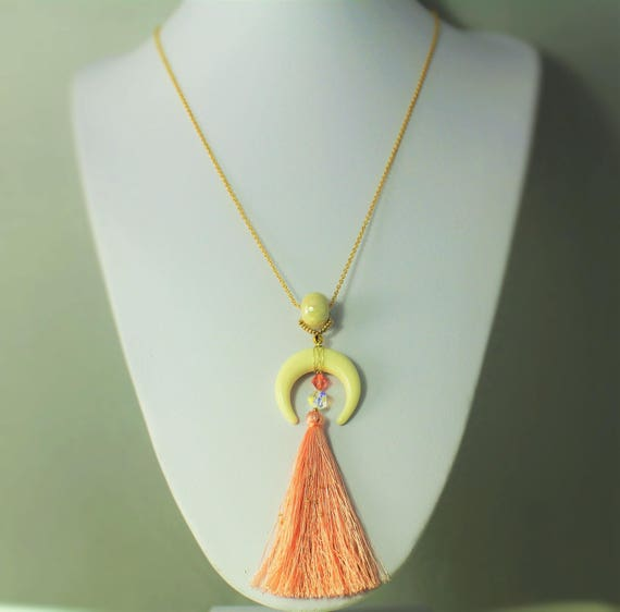 white ivory and coral necklace with tassel and horn