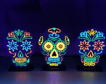 Set of black light skull decorations