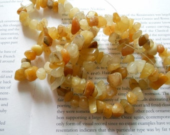 "8-12mm natural yellow jade chip beads, nugget beads, irregular beads, 16"" long."