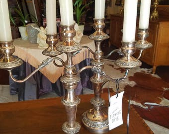Pair of lovely silver candelabra done over copper.
