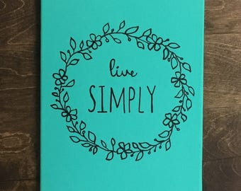 Live Simply with Wreath on Canvas