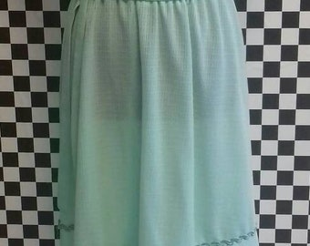 Sheer mint green summer dress from the late 70's with ribbon detail around the neck and skirt with belt - size medium