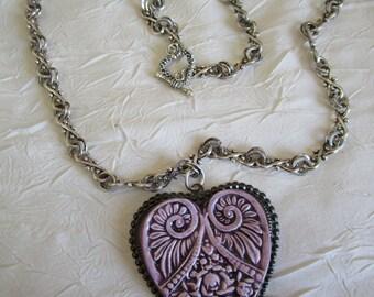 """Charmant collier avec pendentif en céramique """"Un très joli coeur en céramique rose"""""""