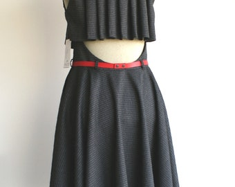 Dark grey dress, pleated back detail, circle skirt