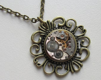 Steampunk Gothic filigree necklace with the smallest vintage watch movement. Gift for Her Cosplay bronze necklace