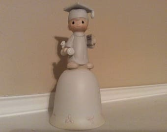 "Precious Moments Boy  Graduate in a Cap and Gown on Top of a Bell ""The Lord Bless You and Keep You"" Enesco E-7175."
