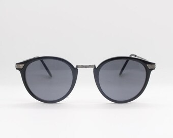 90's vintage sunglasses. Black frame with black lenses. Mens. Womens. 40s style design. Made in Italy. Cat eye.