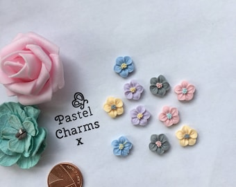 Pack of 10 mixed colour pretry flowers  embellishments 10mm