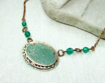 Copper necklace with oriental pattern.