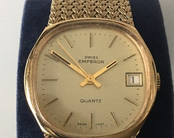 Vintage Swiss Emperor men's dress watch with integral strap and date at the 3