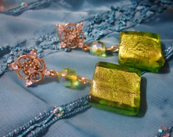 Golden earrings and the bright green
