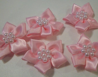 pink ribbon flowers,  with pearl  centre