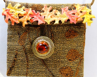 Small Brown Fabric Amulet Bag Necklace with Leaf Embellishments and Fancy Orange Button Follow your Dreams Pretty Pouch