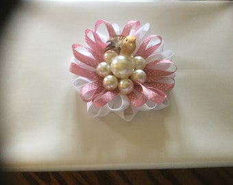 Gift wrap bow with pearls and small bird.