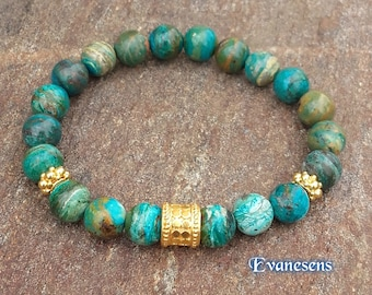 Bracelet opal from Peru, 8mm beads and Bali bead and spacers in 22 k gold Vermeil