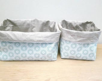 Basket diaper changing table in coated linen baskets and mint green pinwheel printed fabric