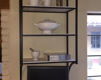 Shelving unit of honed marble and steel