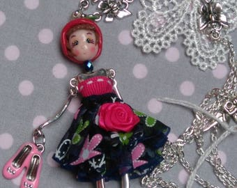 necklace with a pretty doll