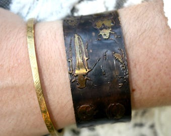 Beetle Etched Brass Cuff Bracelets. Adjustable cuff with etched beetles.