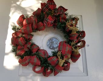 Christmas wreath plaid/flannel style accent with bow and three gold reindeers