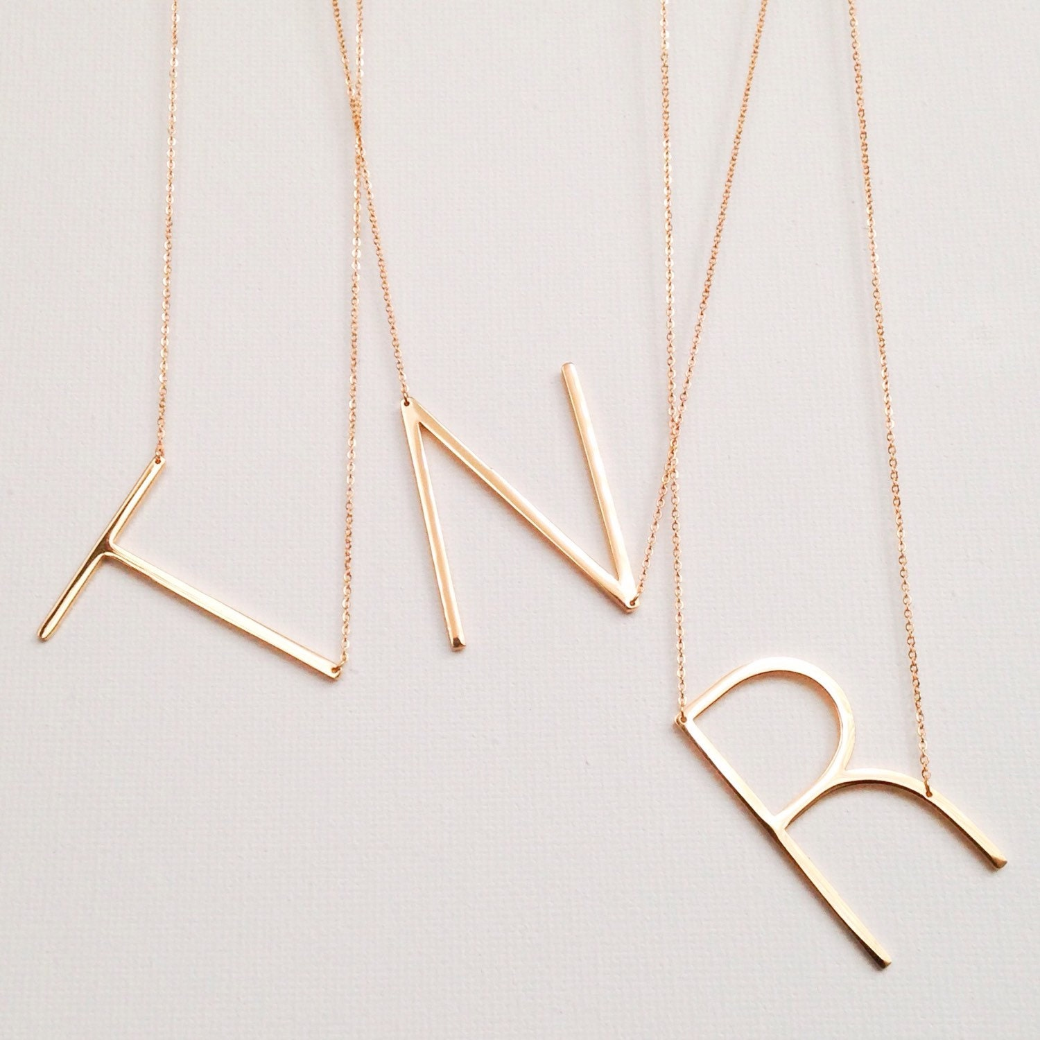 initials initial necklace asymmetrical chains necklaces diamond pin