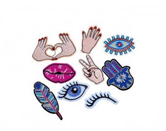Pack of 9 badges heat-sealed patches hands eyes mouth and feather
