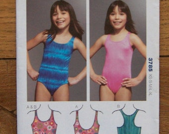 2010 kwik sew pattern child girl swimsuits sz XS-XL   -  4-14  uncut