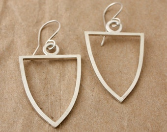 Shield form earrings
