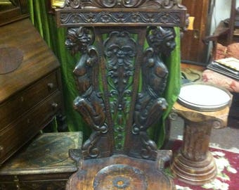 Vintage Renaissance Revival Chair Decorated with Hand Carved Demons and Floral Flourishes