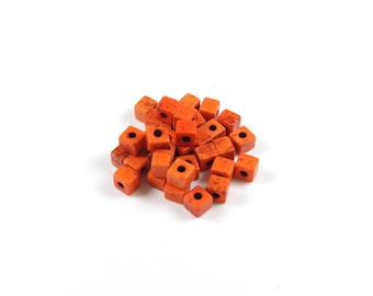 1 strand of approximately 90 beads Turquoise synthetic Orange Cube approximately 4 x 4 x 4mm