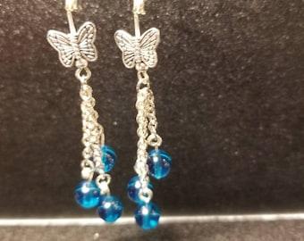 Silver butterflies in the blue rain