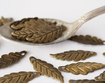 30 Metal Leaf Stampings Charms Leaf Shape Embossed Antique Brass Size 26 x 9.5mm Hole 1mm (medium)