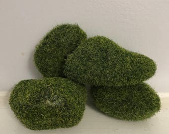Fairy moss covered resting rocks