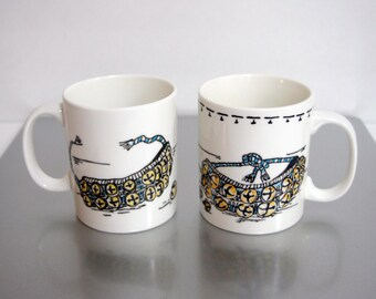 Hand painted, dishwasher safe pair of mugs showcases Indian Ghungaru