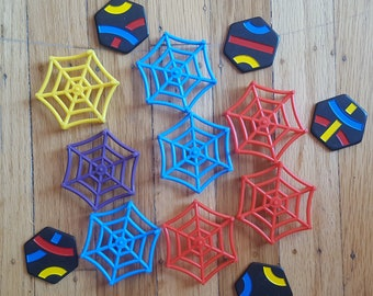 Rainbow colored spiderwebs (or, I suppose, these could be cobwebs) along with rainbow-touched Tantrix pieces create narrative possibilities