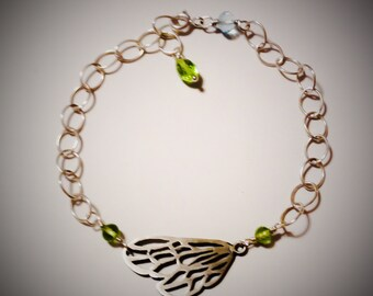 Handmade, Sterling silver wing bracelet with peridot and topaz