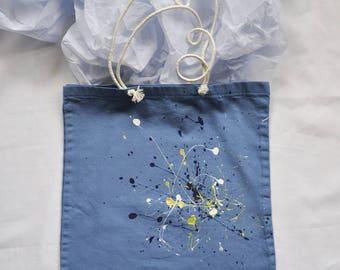 bag blue textile paint stains