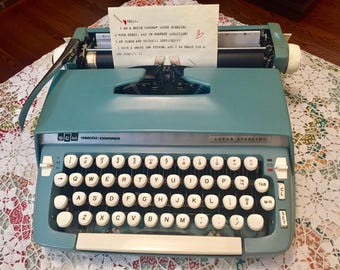 A 1960's Smith Corona Super Sterling Portable Manual Blue Typewriter